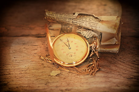 gold-colored pocket watch