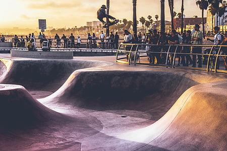 skateboarder jumping off vert
