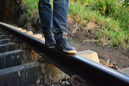 photo of person standing on railway