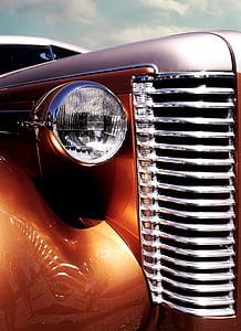 closeup photo of brown vehicle headlight