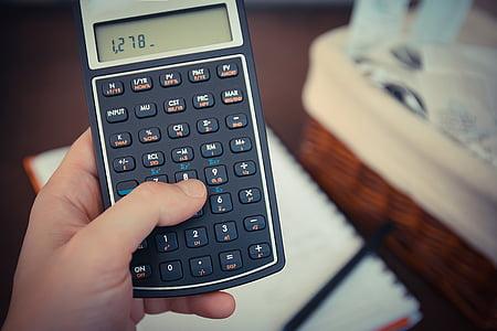 person holding black calculator