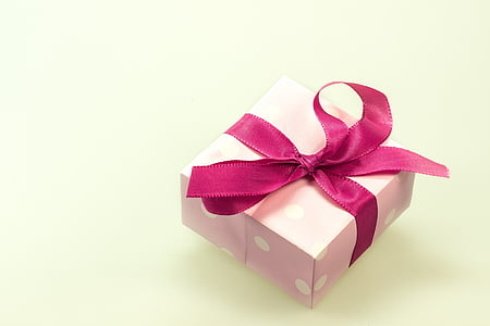 pink and white polka-dot gift box with pink ribbon
