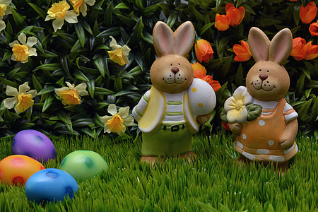 two bunny with Easter eggs on garden