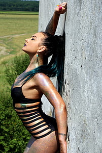woman in black monokini leaning on wall during daytime