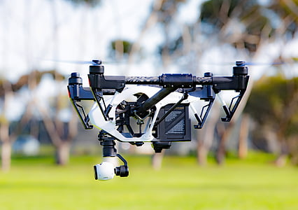 shallow focus photography of black and white quadcopter drone