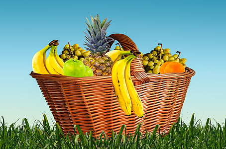 brown wicker basket with assorted fruits