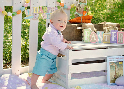 toddler standing near table with dress
