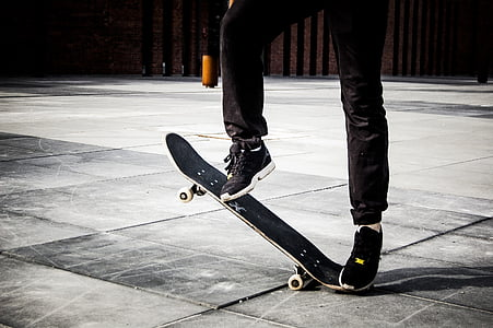 person riding on black skateboard