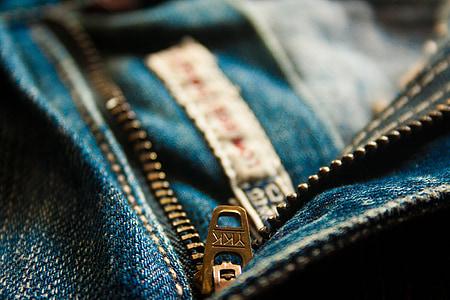 closeup photo of blue denim bottoms