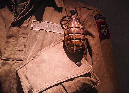 brown grenade on top of uniform