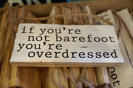 white and brown if you're not barefoot you're overdressed wooden hanging decor
