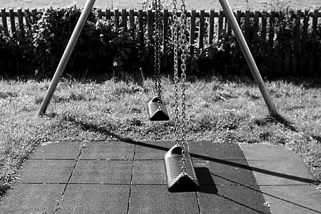 grayscale photography of outdoor swing