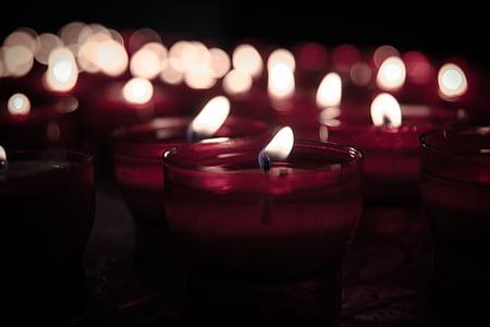 closeup photo of votive candles
