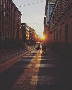 couple walking beside the street