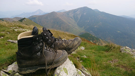 pair of black work boots on mountain