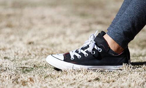 shallow focus photography of pair of black-and-white low-top sneakers