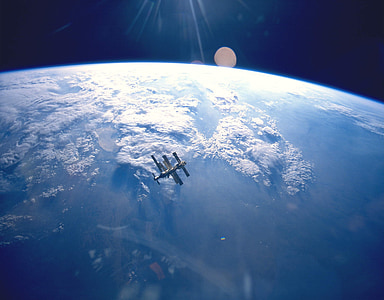 space photography of gray satellite