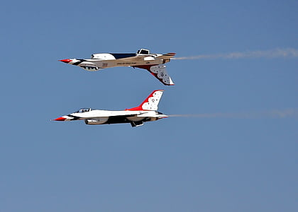 two white aircrafts under blue sky
