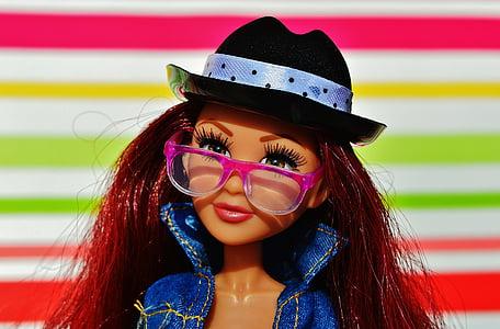 Barbie doll with pink eyeglasses and blue denim jacket