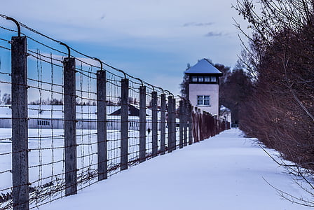 structure enclosed with fence covered in snow