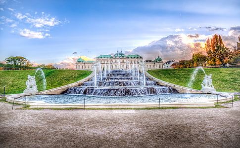 water fountain between green grass field painting