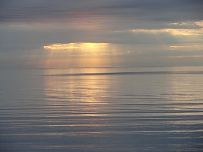 landscape photography of body of water under clouds with sun rays