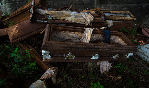 stack of brown coffins