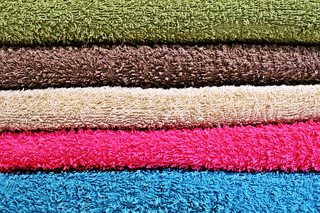 several assorted-color textiles