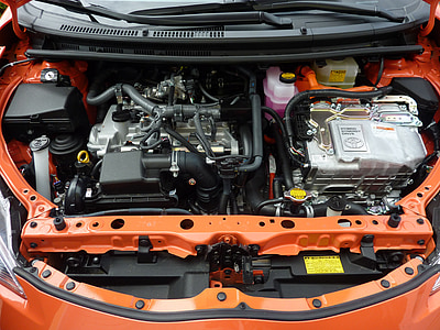 car engine bay of orange car