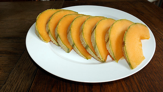 sliced melons on white plate