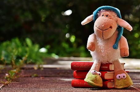 lamp plush toy on books