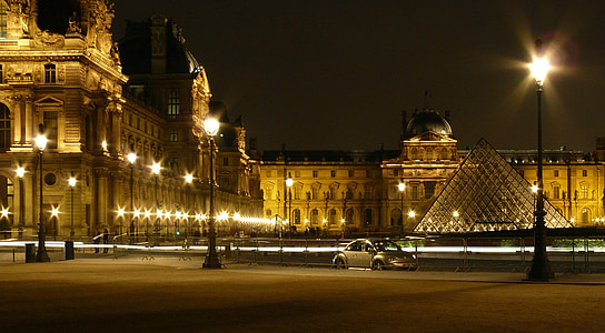 timelapse photography silver Volkswagen New beetle near Louvre Museum at night time