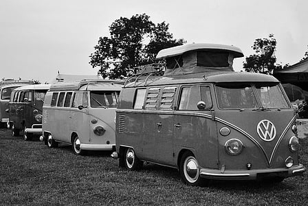 grayscale photography of three Volkswagen Samba parked near green tree