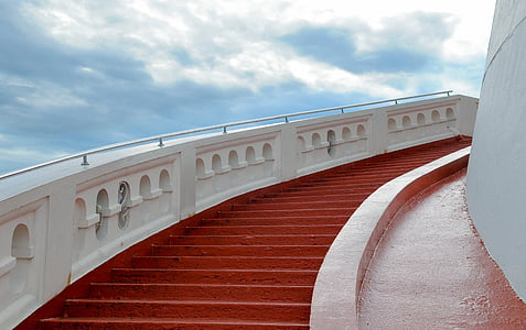 photography of white and red concrete steps