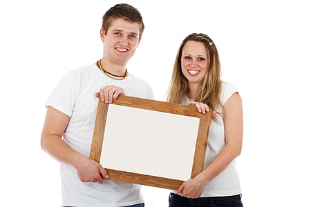 smiling woman and man holding wooden frame