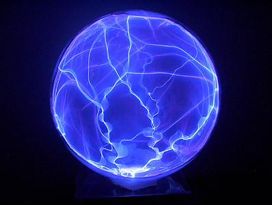 low exposure photo of blue plasma ball