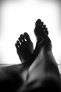 silhouette of a person's feet