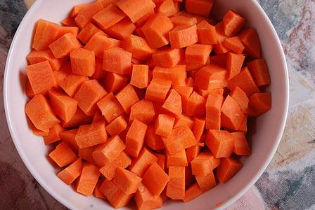 sliced carrots on white ceramic bowl