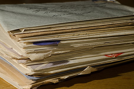 file of papers on brown wood