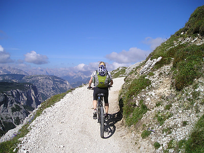 person riding bike on mountain