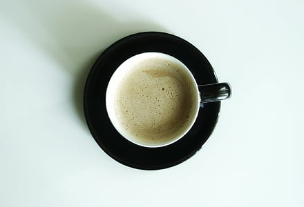 coffee on a black ceramic saucer