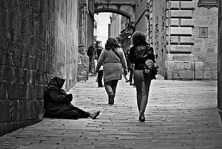 grayscale photo of people walking on concrete hallway