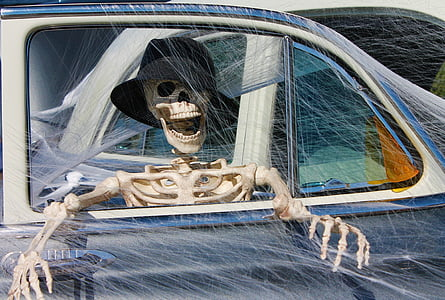 human skeleton inside car painting