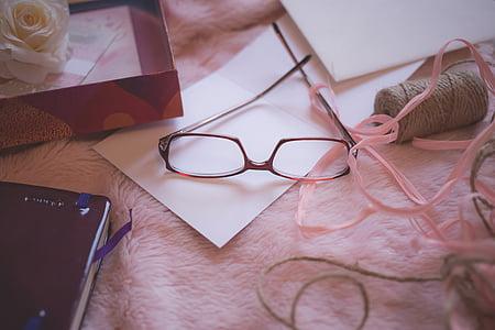brown framed eyeglasses