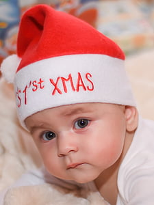 boy wearing a red and white Santa hat