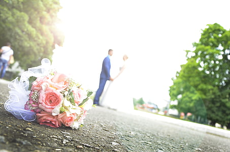 selective focus photo of wedding flower on ground