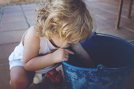 toddler looking in bucket
