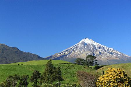 photography of mountain near on field