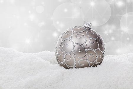 gray bauble on white powder
