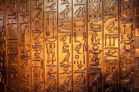 brass-color symbol engraved decor